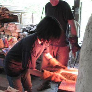 Akiko Uchida - Ceramic Artist - loads wood fire kiln